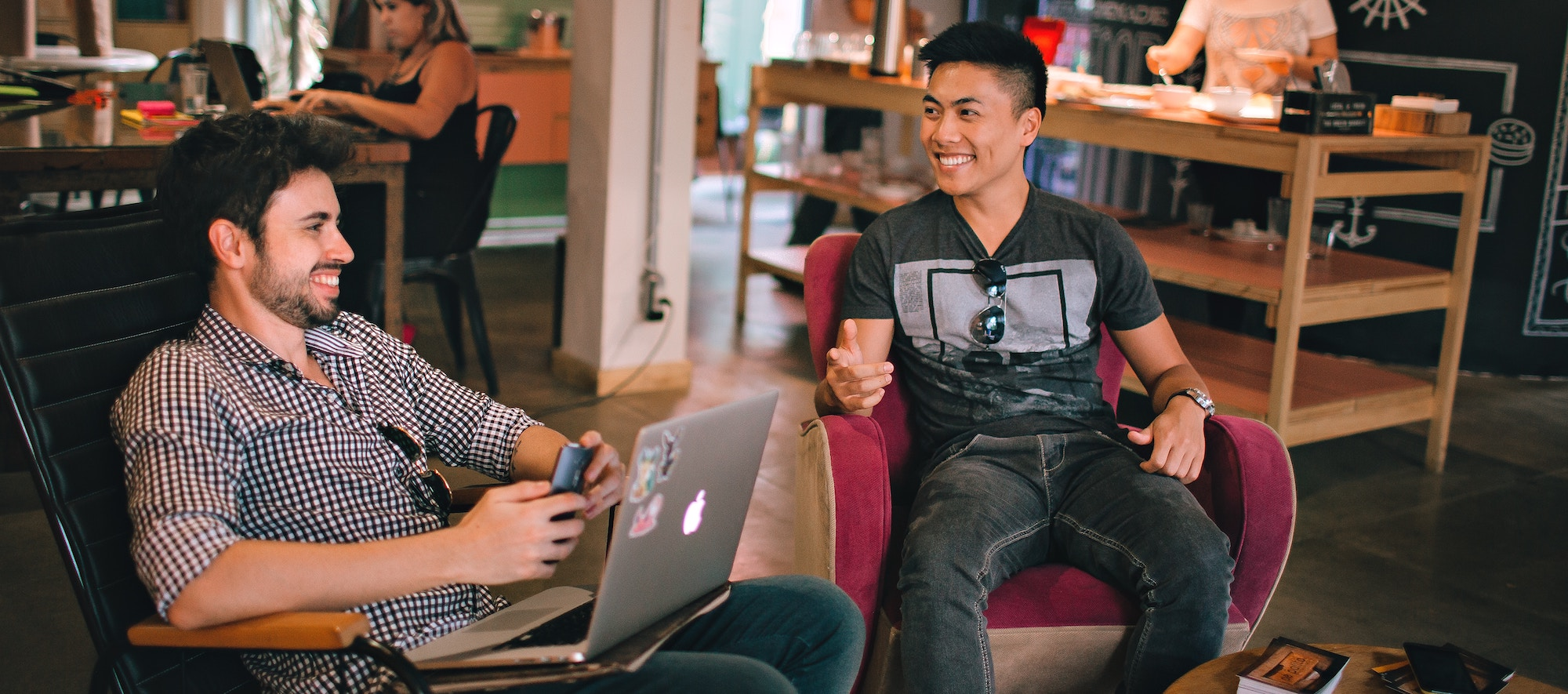 Two guys laughing at coworking space